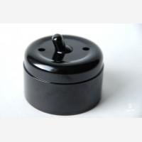 Wall switch, black bakelite, regular button